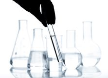 Set of laboratory flasks with a clear liquid Stock Image