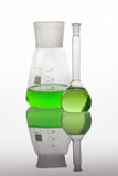 Set of laboratory glassware filled with vibrant liquids. Royalty Free Stock Photography