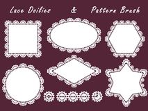 Set of lace napkins different shapes and patterned brush.White element for design  on a dark background. Royalty Free Stock Images