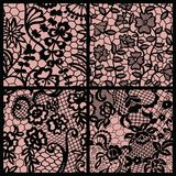 Set of lacy patterns. Black lace seamless patterns with flowers on beige background Stock Photography