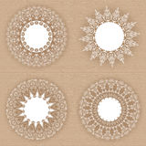 Set of lacy white frames on cardboard background. Set of 4 lacy white frames on the background with the texture of cardboard Stock Photography