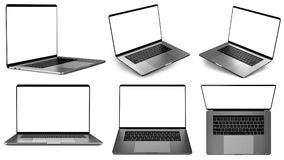 Set of laptops in different positions. Stock Photos