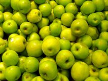 Set of large green apples. Much bright green colours royalty free stock photo