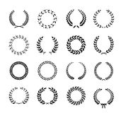 Set of laurel foliate and wheat wreaths. Set of black and white silhouette circular laurel foliate and wheat wreaths depicting an award achievement heraldry royalty free illustration