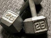 25 lb Barbells. A set of 25 LB iron barbells for working out at home or the gym Royalty Free Stock Photography