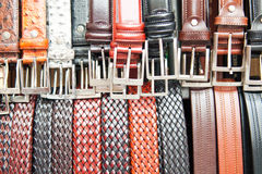 Set of leather belts with metal buckles Stock Photos