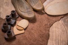 Set of leather craft tools on wooden background. Workplace for shoemaker. royalty free stock photos