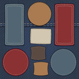 Set of leather labels on denim. Background Stock Images