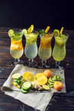 Set lemonade with ice in glass hurricane with tropical fruits Stock Photography