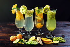 Set lemonade with ice in glass hurricane with tropical fruits Royalty Free Stock Photo