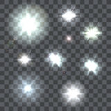 Set of  lens flares beams and flashes on transparent background Royalty Free Stock Photography