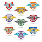 Set of letter badges with wings for logos, t-shirts, school or club crests Royalty Free Stock Photo