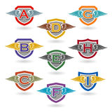 Set of letter shields with wings for logos, t-shirts, emblems. Stock Photography
