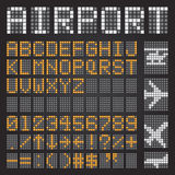 Set of letters on a mechanical timetable, airport symbols Royalty Free Stock Photography