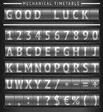 Set of letters on a mechanical timetable Royalty Free Stock Photos
