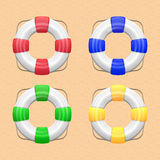 Set of Lifebuoy. Set of White lifebuoy with red, green,blue stripes and rope. Isolated Vector illustration, eps 10 Stock Images