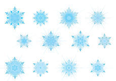 Set of the light blue snowflak. Es. Radial gradient present. Available in AI format Royalty Free Stock Photography