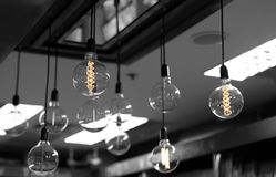 Set of light bulbs decor glowing light. On black and white background Stock Images