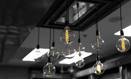 Set of light bulbs decor glowing light. On black and white background Stock Photography