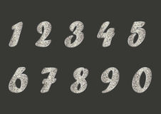 Set of light golden numbers on dark grey background Stock Image