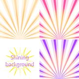 Scroll on a background of sunlight. Set of  light and shining backgrounds with sun rays on the  orange, pink,  purple dawn Royalty Free Stock Images