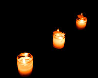 Set of lighting candles in a row on dark background Royalty Free Stock Photos