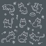Set of line funny cats. Set of funny cats and cat`s toys, vector illustration isolated on dark background Stock Photo