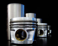 Set of liners and pistons. On black background Royalty Free Stock Images