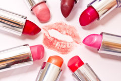 Set of lipsticks around lips mark Stock Photos