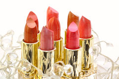 Set of lipsticks decorated with beads Stock Photos