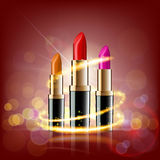 Set of lipsticks on a glowing background. Makeup ads template. S Royalty Free Stock Photo