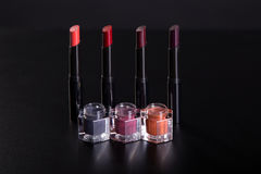 Set of lipsticks and lip glosses on black background Stock Images