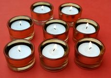 Set of lit candles Royalty Free Stock Photo