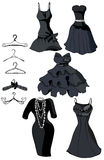 Set of little black dresses and coat racks Stock Photography
