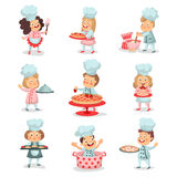 Set of little cook chief kids cartoon characters cooking food and baking detailed colorful Illustrations. Isolated on white background Stock Images