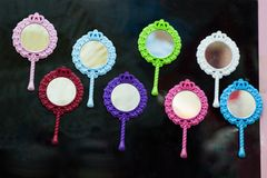 Set of Little decorative hand mirror in the view. Set of little decorative hand mirror on a shelf Royalty Free Stock Photography