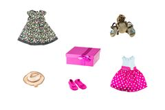 Set of little girl clothes for day of the child. Colorful fashion for party or birthday party. Isolated on white. Close up. Decor stock images