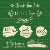 Set logos, labels with natural fresh food sketch designs.Organic Royalty Free Stock Photos