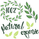 Set of logos, lettering 100%, Natural, organic. Round frame of l. Eaves. Organic food badge in vector (cosmetic, food). Branch with leaves stock illustration