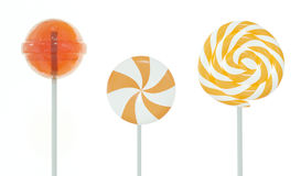 Set of lollipops. Orange set of three different lollipops isolated on white. 3d image Royalty Free Stock Photo