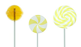 Set of lollipops. Yellow set of three different lollipops isolated on white. 3d image Royalty Free Stock Photography