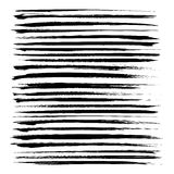 Set of long black textured abstract strokes Stock Photos