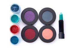 Set of loose and pressed eyeshadows, and lipstick Stock Photography