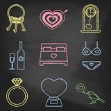 Set of love icons painted with colorful chalk on a blackboard. Decorative icons for Valentine's day. Hands-drawn style Stock Image