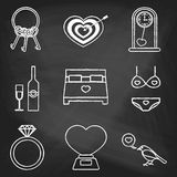 Set of love icons painted with white chalk on a blackboard. Decorative icons for Valentine's day. Hands-drawn style Royalty Free Stock Photography