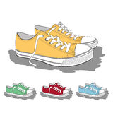 Set of low sneakers drawn in a sketch style. Stock Photography