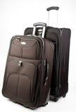 Set of Luggage. Black Set of Luggage On Wheels with Handle Up Stock Photo