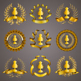 Set of luxury gold cups. Set of luxury golden champion cups, medals, emblems with gold laurel wreaths, ribbons for page, web design. Filigree elements, icons Royalty Free Stock Image