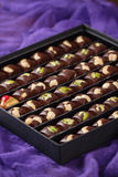 Set of Luxury handmade chocolate candies with nuts in gift box Stock Image