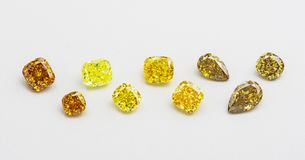 Set of luxury yellow and brown transparent sparkling gemstones of various cut shape diamonds collage on white background stock images